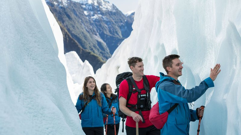 Franz Josef Glacier Guides touching ice
