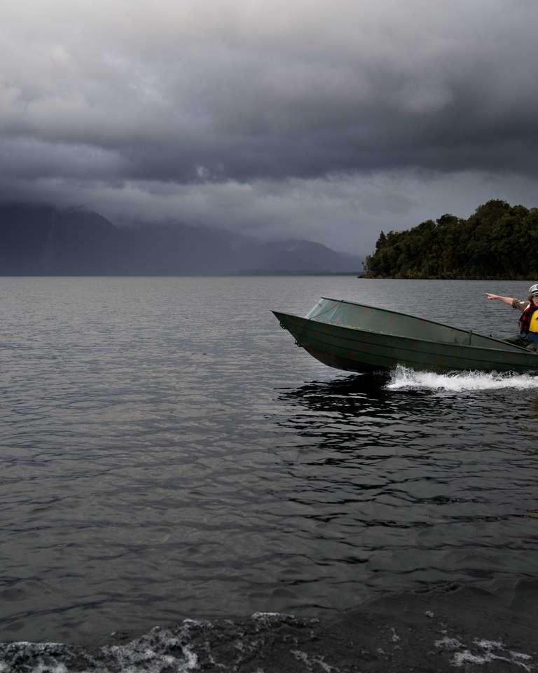 Wide shot of Te Radar boating at Lake Brunner
