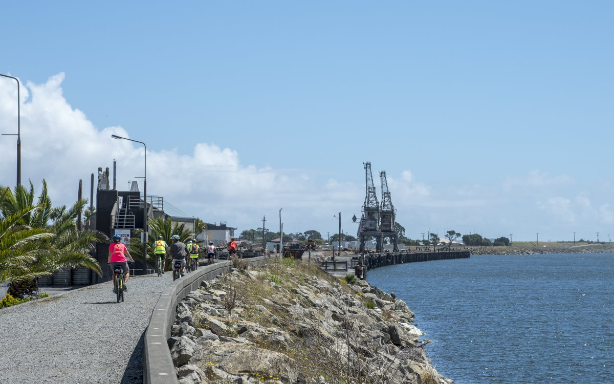 Cyclists on the West Coast Wilderness Trail at Mawhera Quay