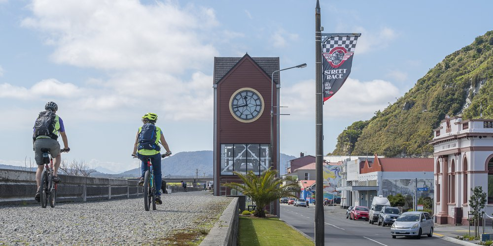 Cycling along Mawhera Quay in Greymouth