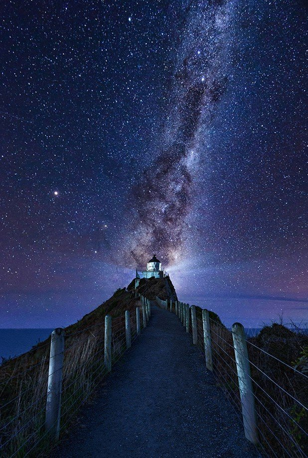 core of the milky way rising behind the Nugget Point Lighthouse.jpg