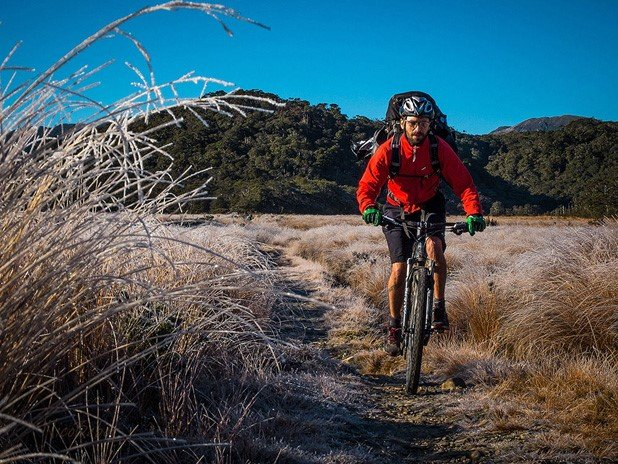 mountain biker fighting the morning frost on the heaphy track.jpg